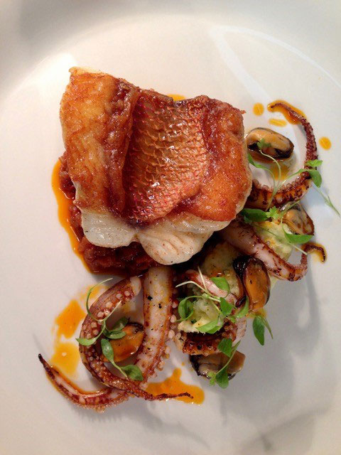 crispy skin sea bass with charred octopus and sofrito