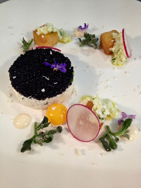fresh crab with beluga caviar quail egg and brioche crouton
