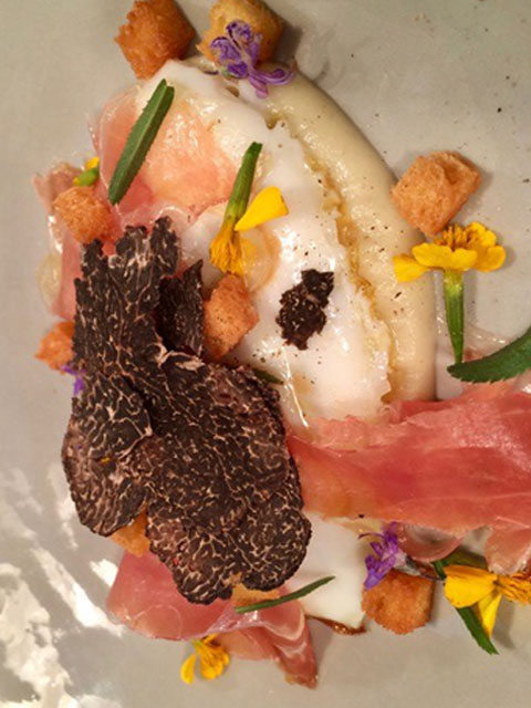 pan fried organic-duck egg with iberico summer truffles and artichoke