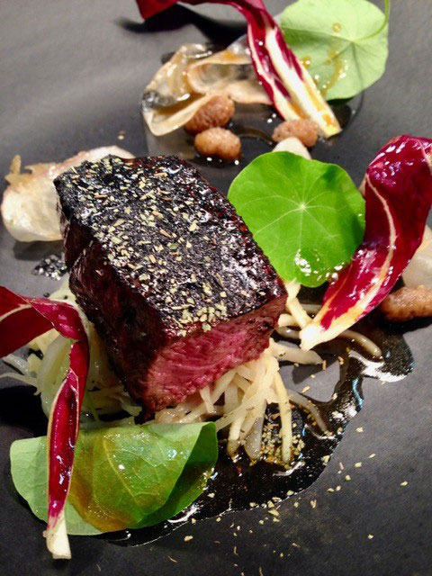 pepper crusted venison loin pickled onion parsnip and white mulberry