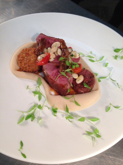 seared duck breast with haricot beans homemade duck sausage and crispy croquette